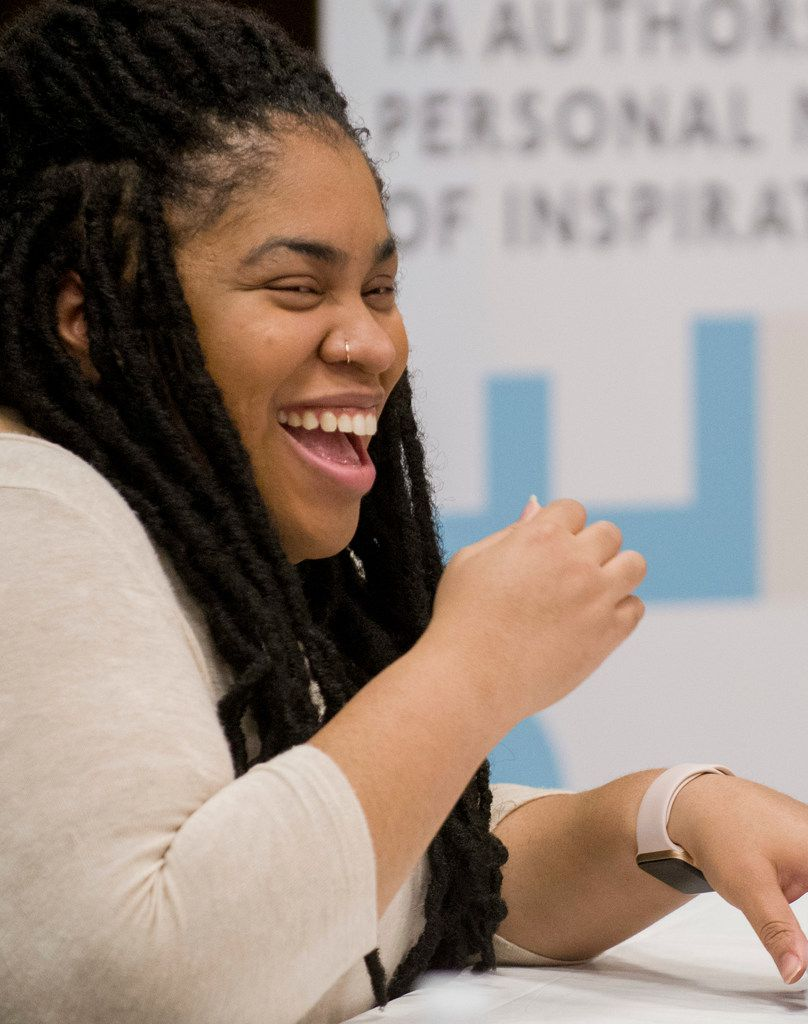Author Angie Thomas laughs while participating in a panel discussion at the South Irving Library in Irving on Feb. 25, 2018.