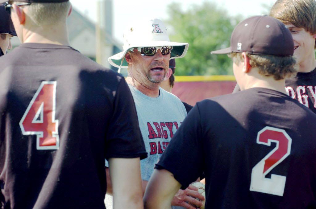 Argyle baseball head coach Ricky Griffin talks to the team after practice, Wednesday, May 26, 2010 in Argyle.