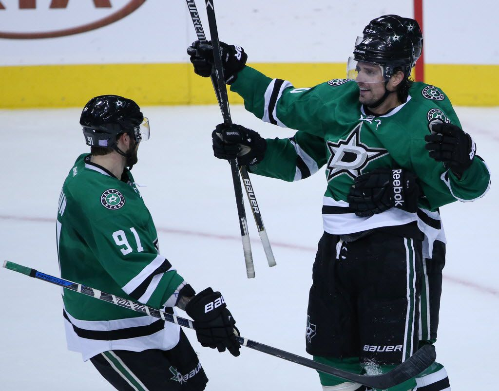 Dallas Stars left wing Patrick Sharp (10), defenseman Jason Demers (4) and center Tyler Seguin (91) celebrate after Sharp scored a goal in the second period during a National Hockey League game between the Toronto Maple Leafs and the Dallas Stars at the American Airlines Center in Dallas Tuesday November 10, 2015. (Andy Jacobsohn/The Dallas Morning News)