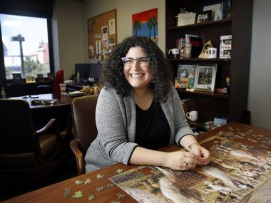 """Assistant U.S. attorney Nicole Dana, whose office includes a puzzle table where she and colleagues work off stress, is considered a top-notch prosecutor who is also """"cheerleader and therapist"""" for the team."""