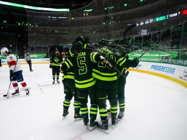 Dallas Stars players celebrate a goal by center Joel L'Esperance (38) during the third period of an NHL hockey game against the Florida Panthers at the American Airlines Center on Saturday, March 27, 2021, in Dallas.