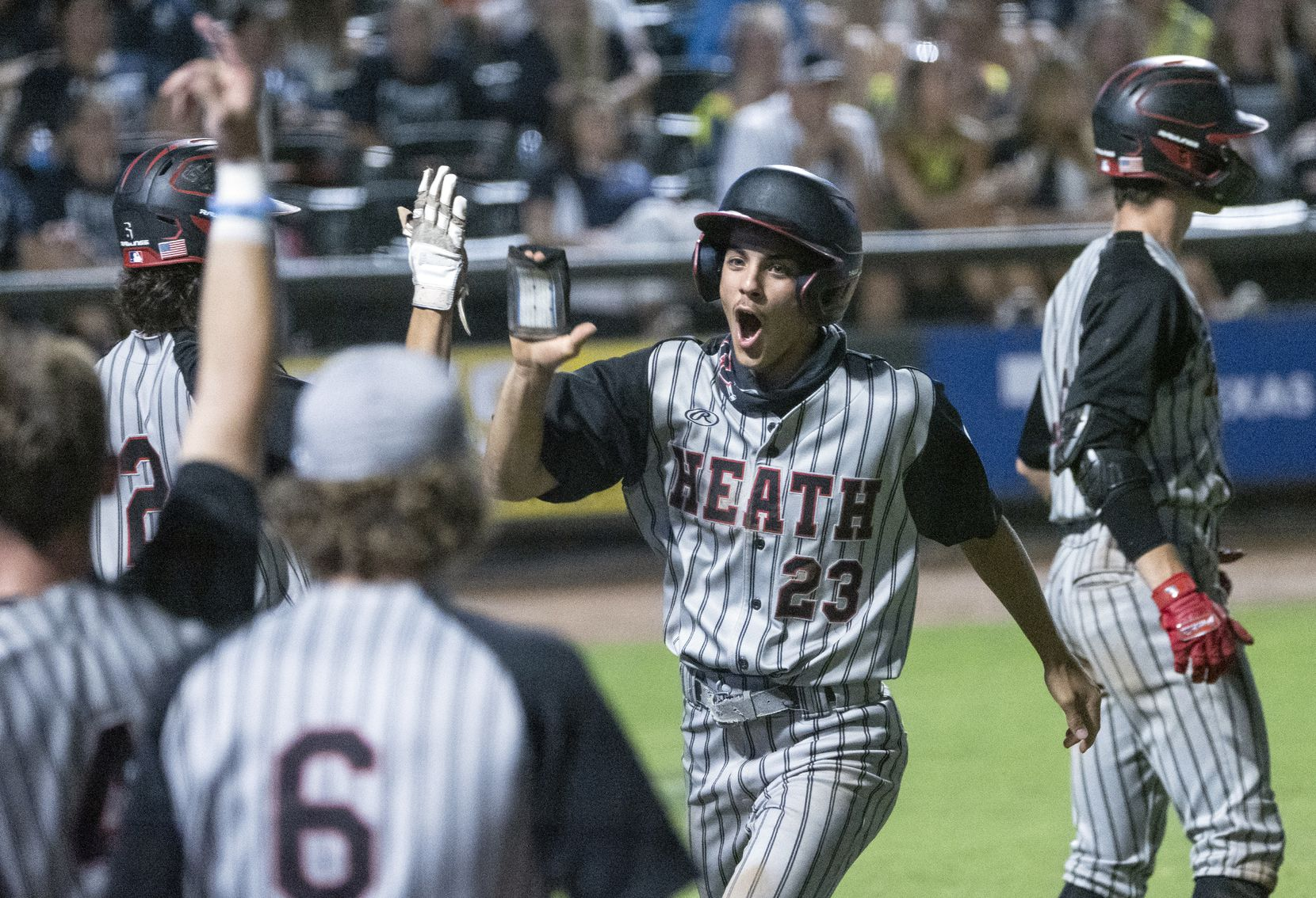 Rockwell-Heath Gage Barkley, (23), celebrates with teammates after scoring against Comal Smithson Valley during the sixth inning of the 2021 UIL 6A state baseball semifinals held, Friday, June 11, 2021, in Round Rock, Texas. Rockwell-Heath defeated Comal Smithson Valley 8-4.    (Rodolfo Gonzalez/Special Contributor)