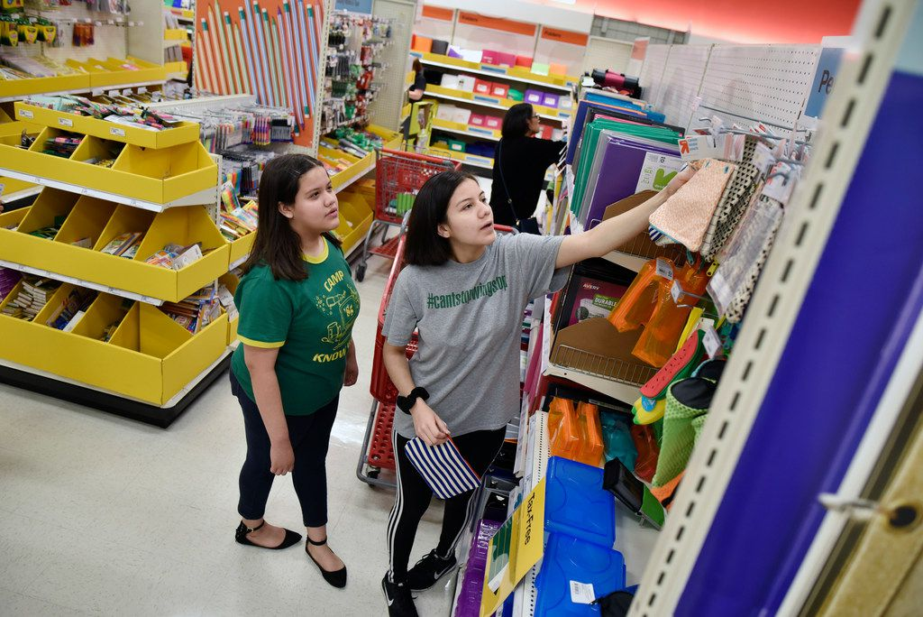 Laura Torres, 12, and her sister Vaneza Torres, 17, shop for back to school supplies during tax free weekend at a Target in North West Dallas, Friday Aug. 09, 2019. Ben Torres/Special Contributor