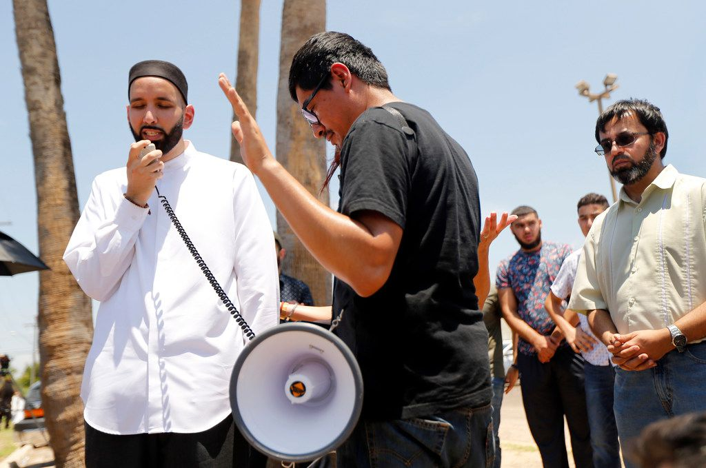 Imam Omar Suleiman of Irving, Texas leads a group of Dallas area protestors in prayer outside the US Border Patrol Processing Center in McAllen, Texas, Saturday, June 23, 2018.