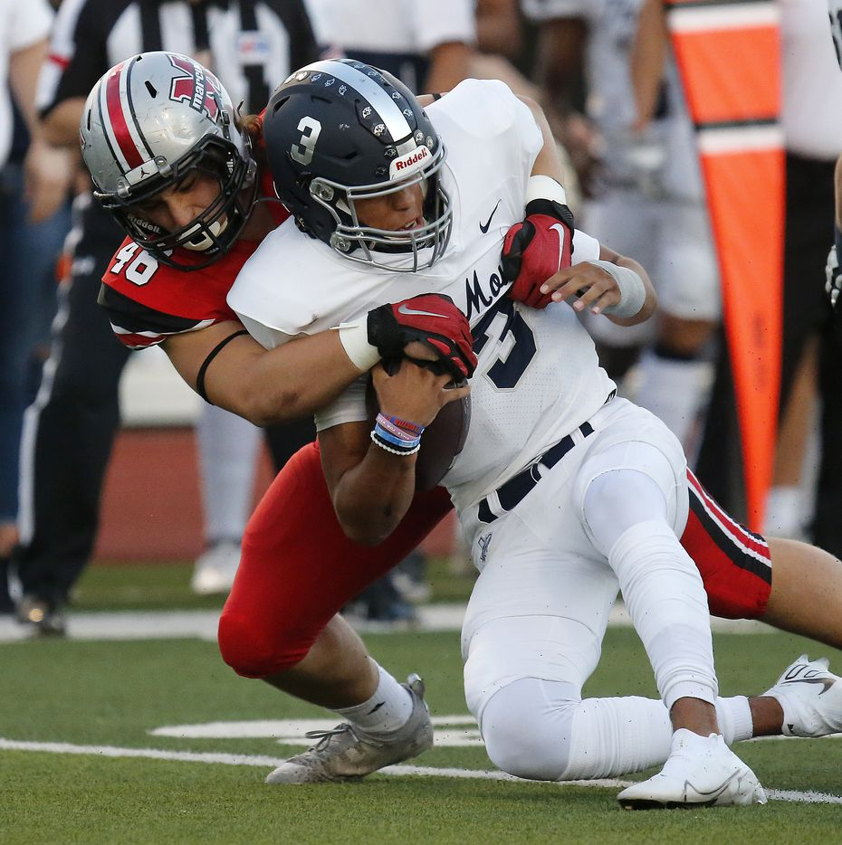 Flower Mound High School quarterback Nick Evers (3) is stopped short of the line of scrimmage by Flower Mound Marcus High School defensive lineman Jacob Geddes (46) during the first half as Flower Mound Marcus hosted Flower Mound High School in a district 6-6A football game at Marauder Stadium in Flower Mound on Friday night, September 24, 2021. (Stewart F. House/Special Contributor)