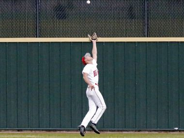 Braswell rightfielder Dylan Krause (26) makes an over the shoulder running catch for an out in the first inning as Denton Braswell High School hosted Prosper High School in a district 5-6A baseball game played in Aubrey on Friday, April 16, 2021.  (Stewart F. House/Special Contributor)