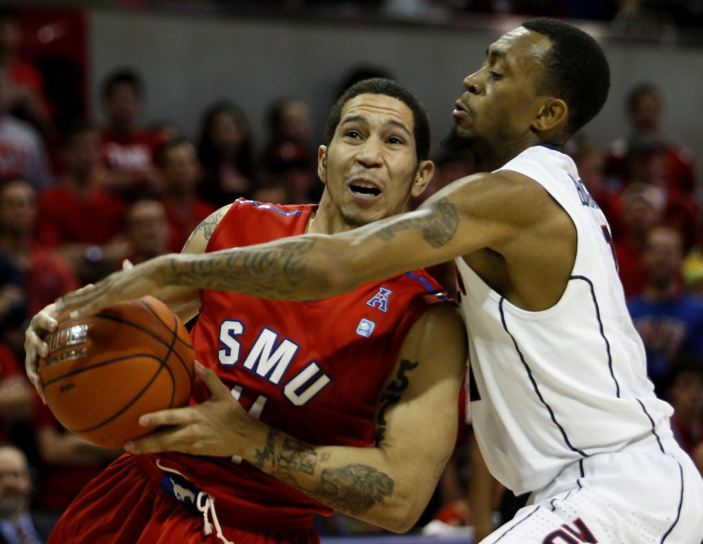 FILE - SMU guard Nic Moore( left) battles UConn guard Ryan Boatright (11) for possession during the second half of a game Jan. 4, 2014, in Moody Coliseum in Dallas. (Sarah Hoffman/The Dallas Morning News)