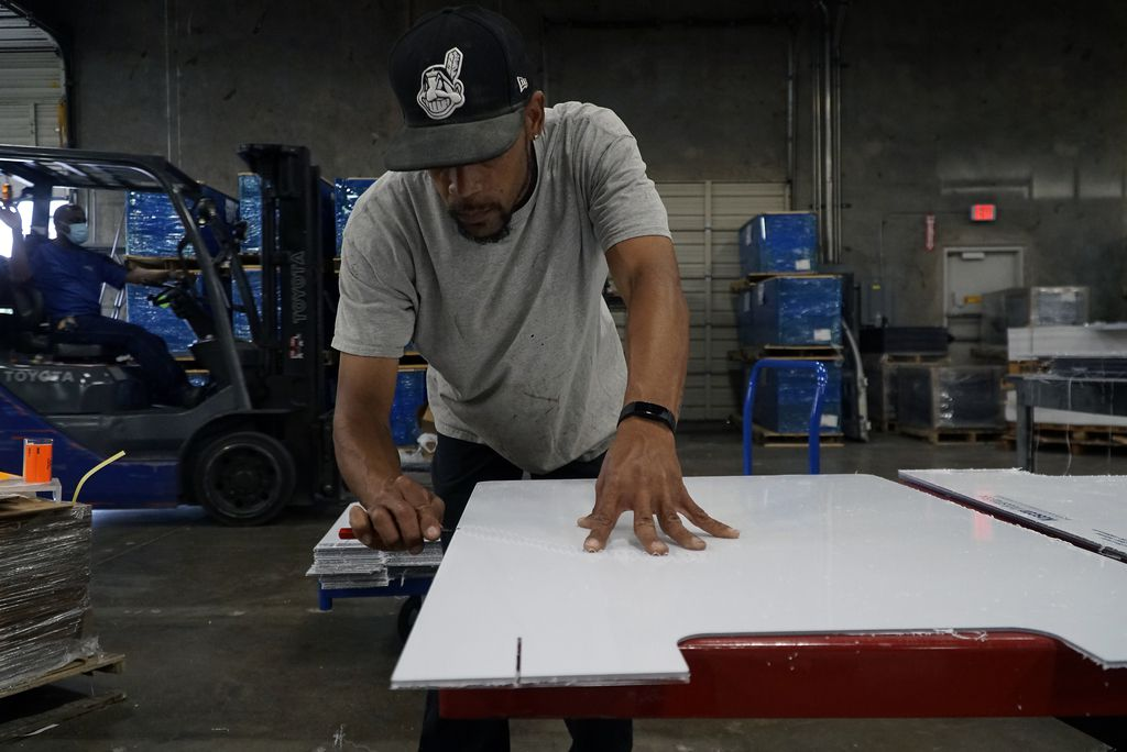 Fabricator Brandon Dodson prepares a sneeze guard at Regal Plastics in Irving.