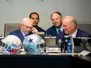 FILE - Cowboys owner Jerry Jones (bottom left), executive vice president Stephen Jones (bottom right) and other team executives wait to make Dallas' first-round draft pick in the war room on Thursday, April 26, 2018, at The Star in Frisco.