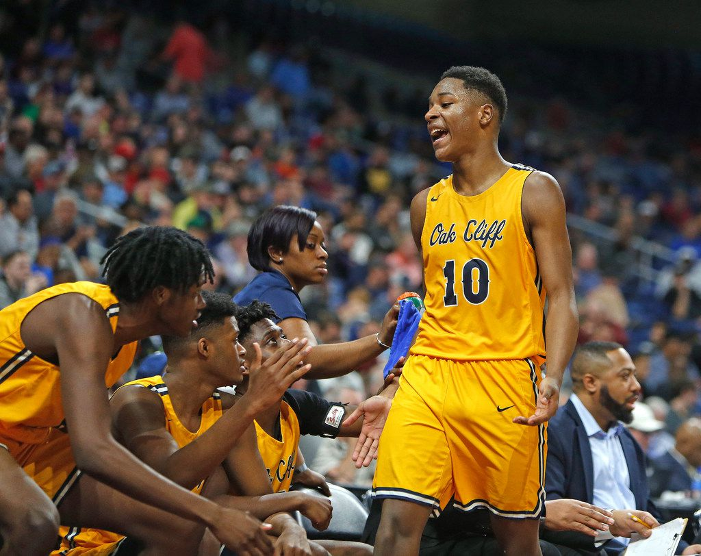 Oak Cliff Faith Academy's Trae Clayton #10 celebrates as he comes to the bench late in the game. UIL boys basketball 4A State semi-final between Houston Yates and Oak Cliff on Friday, March 8, 2019 at the Alamodome in San Antonio, Texas. (Ron Cortes/ Special Contributor) ORG XMIT: 10044095A