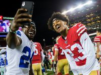 Dallas Cowboys cornerback Chidobe Awuzie (24) takes a selfie with San Francisco 49ers cornerback Ahkello Witherspoon (23) after an NFL preseason game between the Dallas Cowboys and the San Francisco 49ers on Saturday, August 10, 2019 at Levi's Stadium in Santa Clara, California.