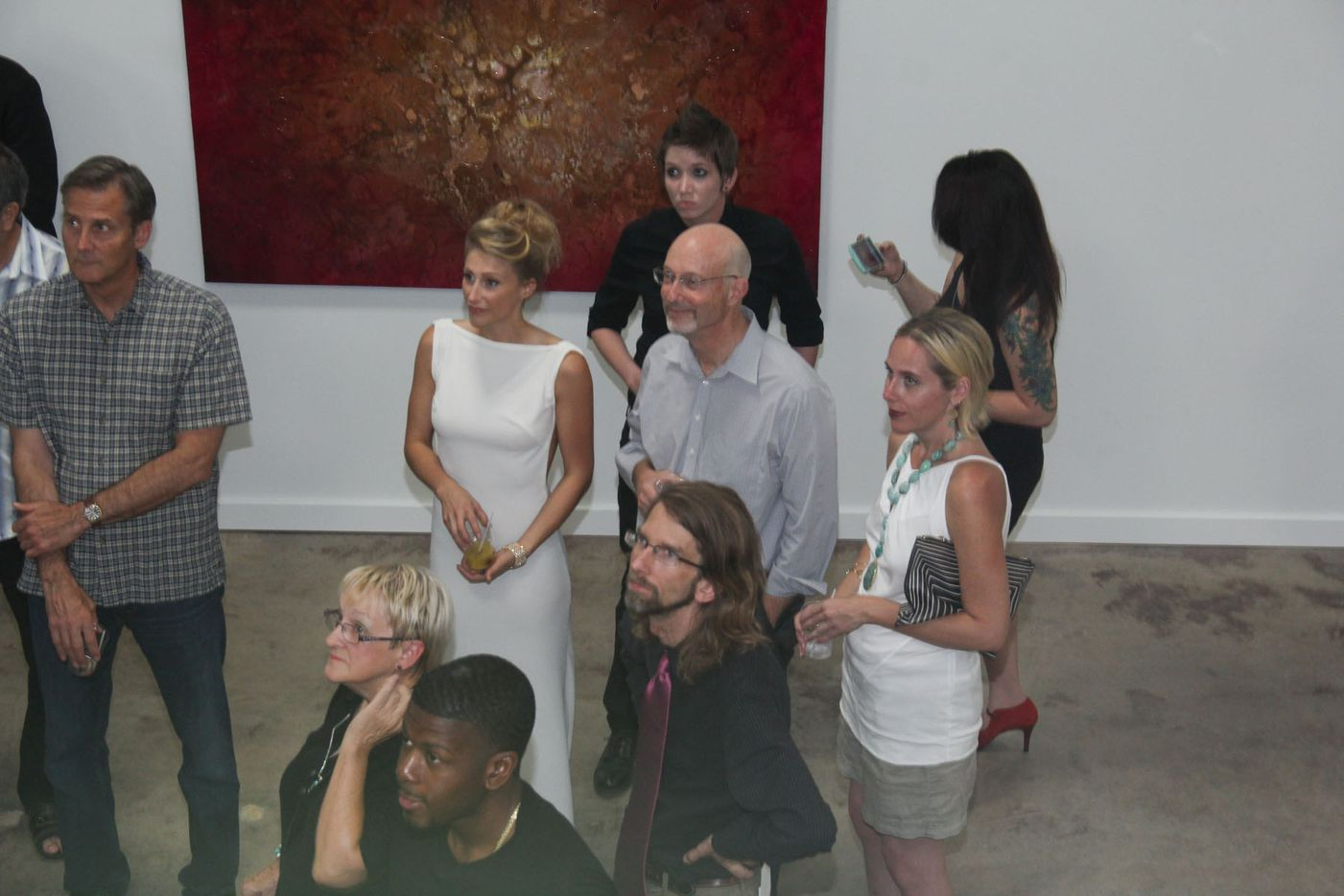 """Random Art Gallery hosted the opening reception of visual artist Tori Martin's Euphoria. Martin, at center, wore a white dress designed by her friend and Dallas-based fashion designer Nicholas J. Moore. """"When you work so hard, you want to feel pretty on that night,"""" Martin said."""