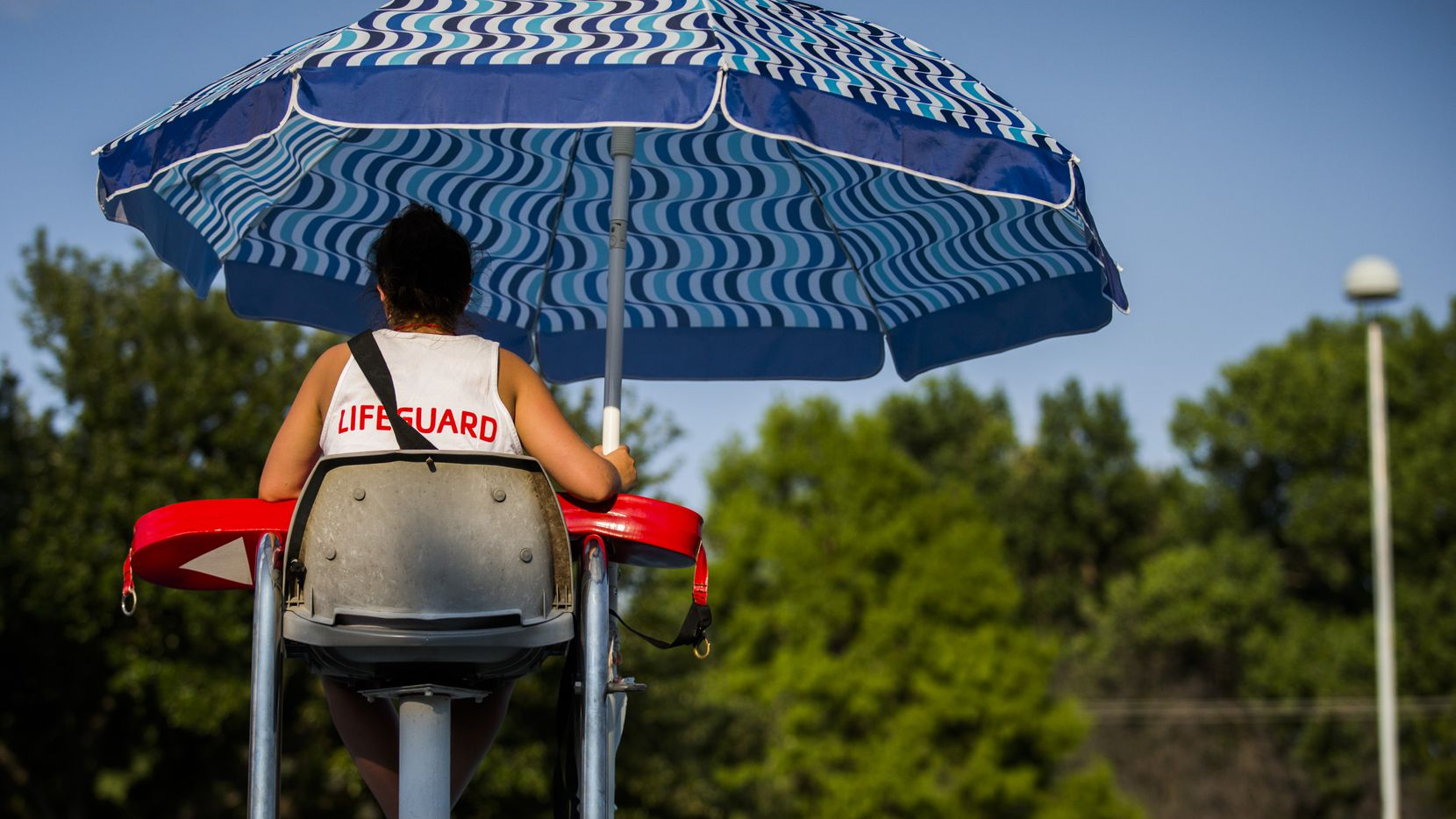 A lifeguard watches the pool at the Richardson Family YMCA in Richardson.