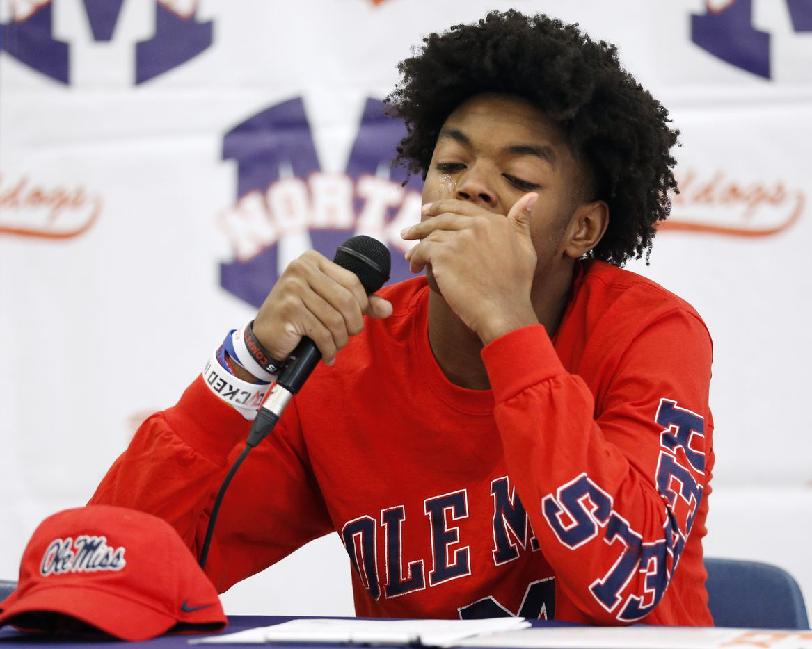 McKinney North wide receiver J.J. Henry gets emotional as he talks about losing his mother to breast cancer during a signing day ceremony at McKinney North High School on Wednesday, December 16, 2020 in McKinney, Texas. Henry signed his letter of intent to play for the University of Mississippi. (Vernon Bryant/The Dallas Morning News)
