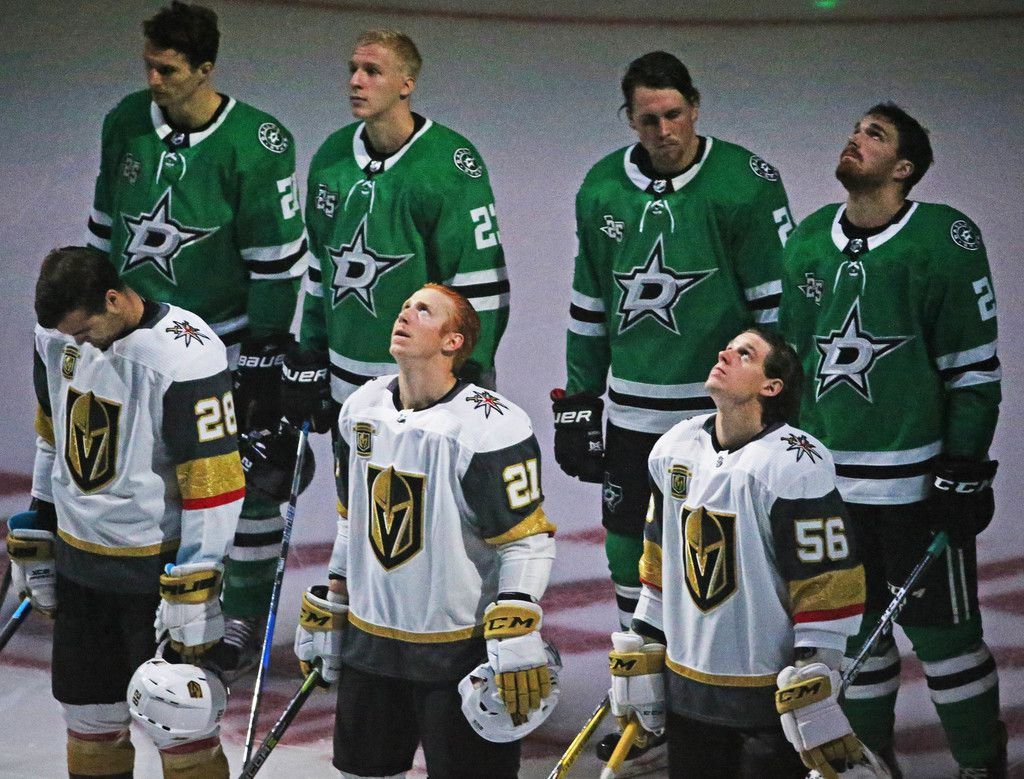 The Dallas Stars team takes up a position behind the Vegas Golden Knights team as a show of support during the national anthem before the Dallas Stars vs. the Vegas Golden Knights NHL hockey game at American Airlines Center in Dallas on Friday, October 6, 2017. (Louis DeLuca/The Dallas Morning News)