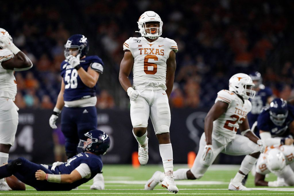 HOUSTON, TX - SEPTEMBER 14:  Juwan Mitchell #6 of the Texas Longhorns celebrates after sacking Tom Stewart #14 of the Rice Owls in the second half at NRG Stadium on September 14, 2019 in Houston, Texas.  (Photo by Tim Warner/Getty Images)