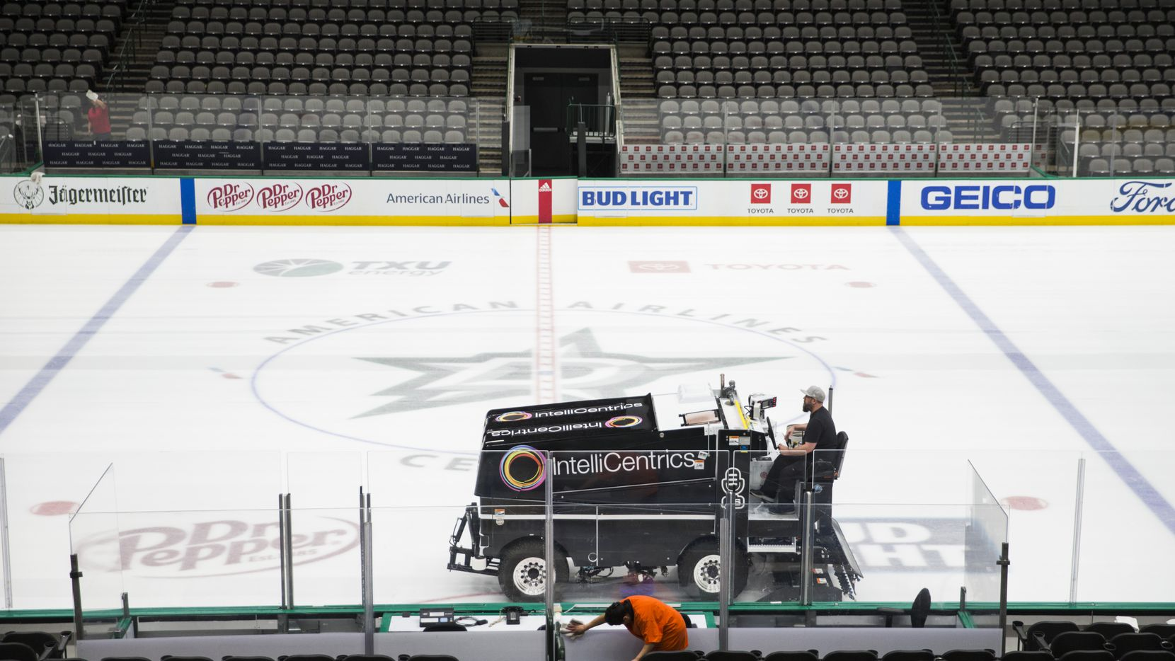 Crews clean and prepare to cover the Dallas Stars ice after the NHL season was put on hold due to coronavirus on Thursday, March 12, 2020 at American Airlines Center in Dallas.