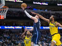 FILE - Mavericks guard Luka Doncic (77) goes up for a shot against Pacers forward T.J. Warren (1) and center Myles Turner (33) during the first quarter of a game on Sunday, March 8, 2020, at American Airlines Center in Dallas.