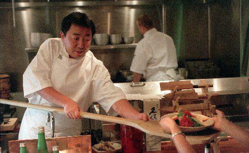 Teiichi Sakurai serves robata to diners at Tei Tei in 2002