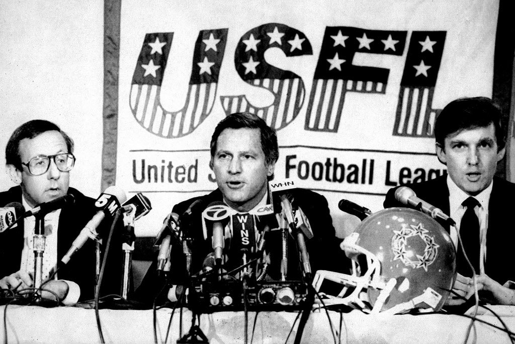 New York real estate magnates Stephen Ross, left, and Donald Trump, right, speak about the agreement they have reached in principle to merge the Houston Gamblers and New Jersey Generals football franchises, in New York. USFL Commissioner Harry L. Usher, center, announced the agreement.