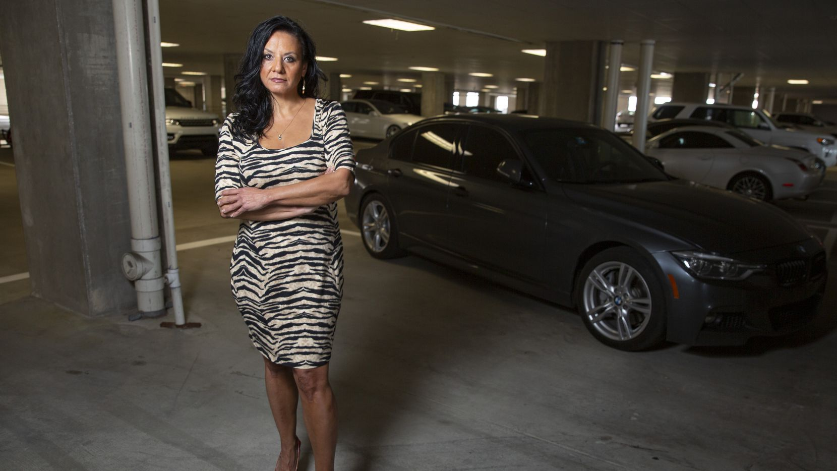 Melissa Anderson stands in the parking garage where not one but two Corvettes belonging to her were stolen this year. All together, she learned that 11 expensive cars were stolen since January from the garage at 1400 Hi Line Drive in the AMLI Design District in Dallas.
