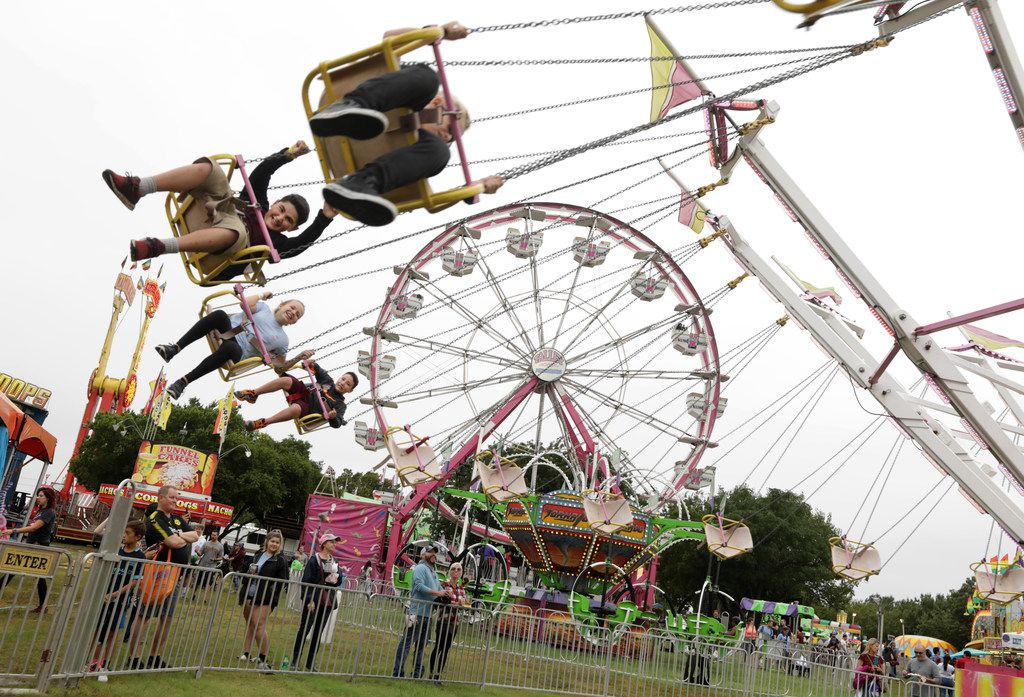 Families enjoy carnival rides during Addison Oktoberfest in 2018. This year's event is Sept. 13-15.
