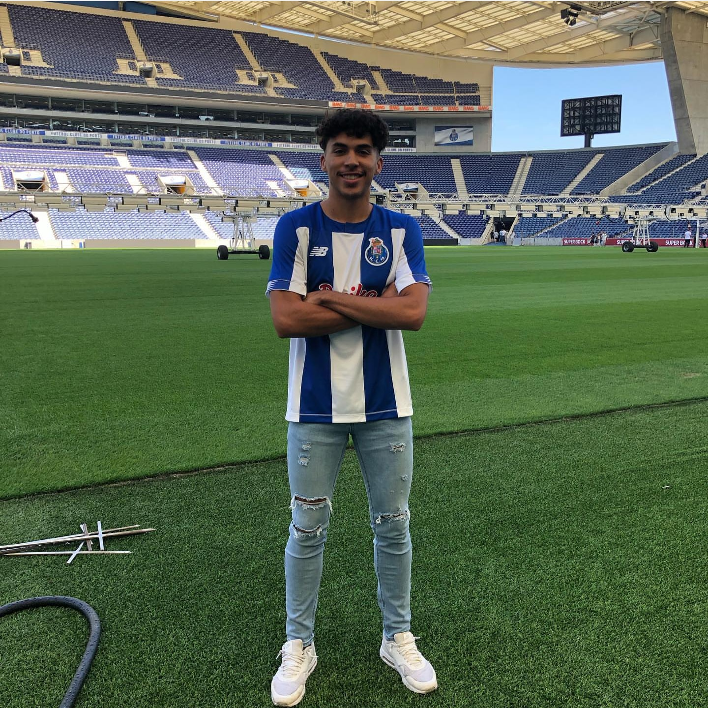 Johan Gomez poses in a FC Porto jersey in the Estádio do Dragão in Porto, Portugal