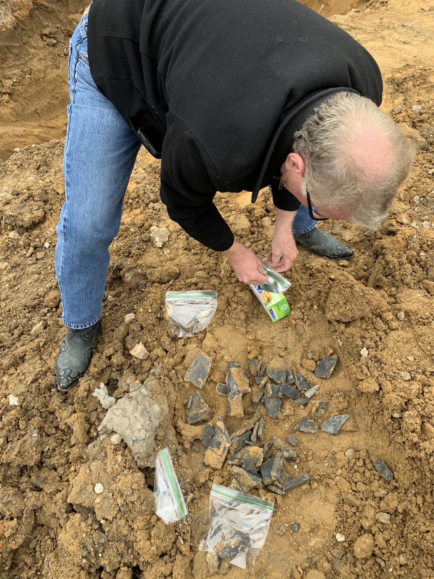 On Monday, Jim Schermbeck collected samples of the black plastic found in the dirt. They will be given to a metals toxicologist this week for testing.