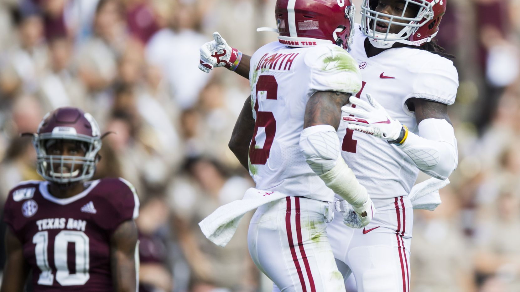 Texas A&M Aggies defensive back Myles Jones (10) rolls his eyes as Alabama Crimson Tide wide receiver DeVonta Smith (6) and wide receiver Jerry Jeudy (4) celebrate a touchdown during the first quarter of a college football game between Texas A&M and Alabama on Saturday, October 12, 2019 at Kyle Field in College Station, Texas.
