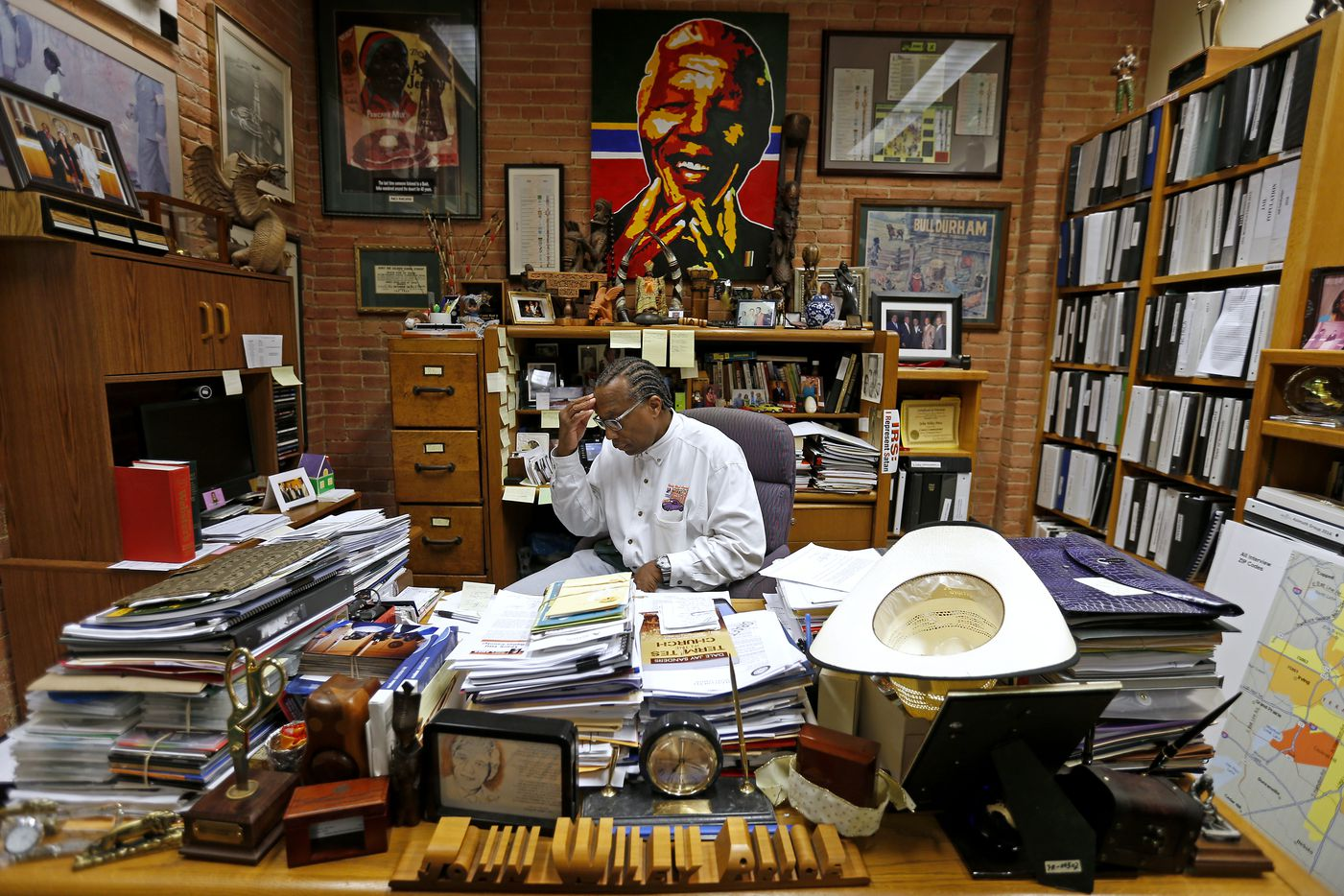 Commissioner John Wiley Price works in his office in June 2016. He says he reads every document that comes across his desk.