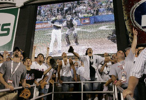 Fans in the bleacher seats watch a home run by Texas Rangers' Josh Hamilton (on screen) during the Major League Baseball All-Star Home Run Derby at Yankee Stadium in New York on Monday, July 14, 2008. (AP Photo/Frank Franklin II)