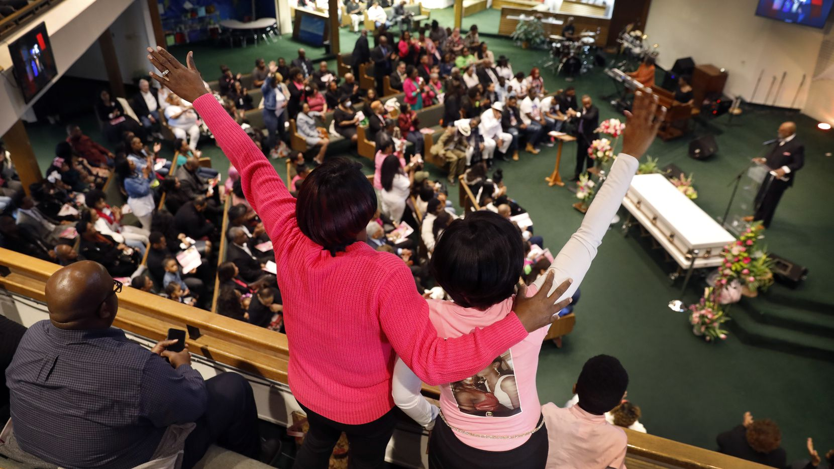 Mourners sing along during a funeral service for LaTiffiney Rodgers, 26, at the CrossRoads Covenant Church in DeSoto on Feb. 22. Police say Rodgers was killed by the father of her children, Johnnie Palmore.
