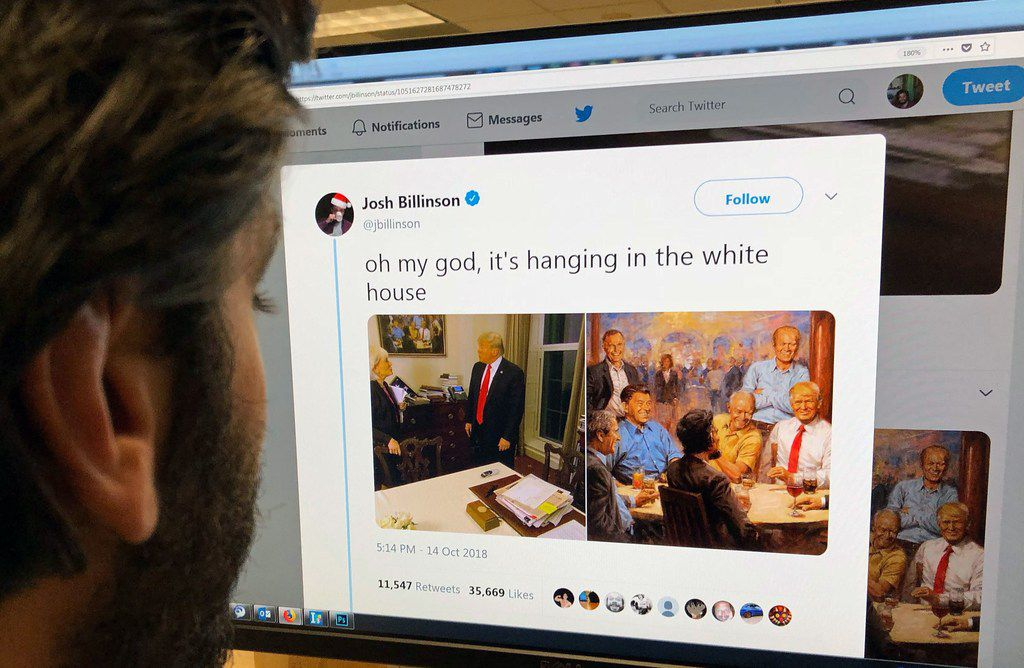 An editor looks at the Twitter feed of Josh Billinson showing a painting by Andy Thomas titled The Republican Club alongside a screen shot of the painting hanging at the White House during a 60 Minutes interview with President Donald Trump.