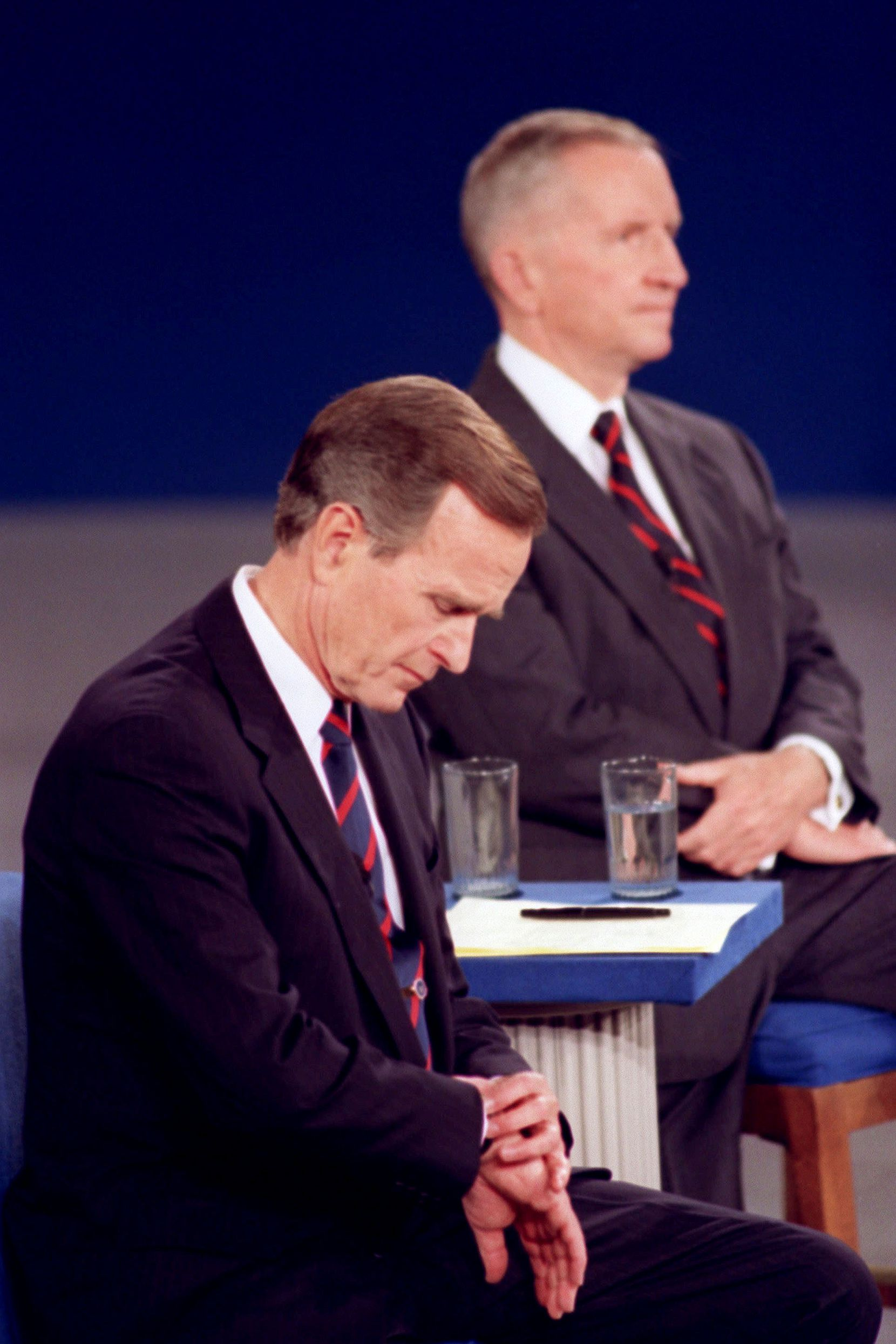 1992:  In an indelible moment from the annals of televised presidential debates, President George H.W. Bush looks at his watch during a presidential debate at the University of Richmond. Independent candidate Ross Perot is at rear. Body language speaks volumes in televised debates, and classic moments sometimes have more to do with what the candidates do — or don't do —than what they say.