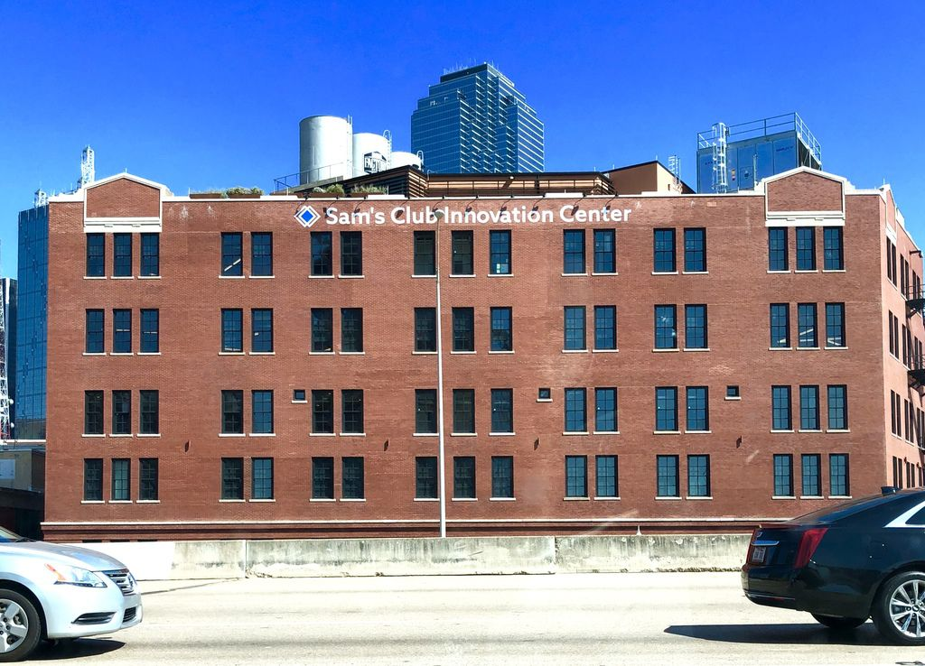 Sam's Club Innovation Center opened in 2018 in a renovated historic building at 603 Munger Ave., in the West End area of downtown Dallas. This is a view from Woodall Rodgers Freeway.