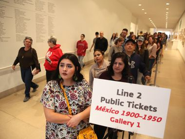 "Leslie Marrufozo (front) waits in line for the ""Mexico 1900-1950: Diego Rivera, Frida Kahlo, Jose Clemente Orozco, and the Avant-Garde"" exhibit at the Dallas Museum of Art in Dallas in March."