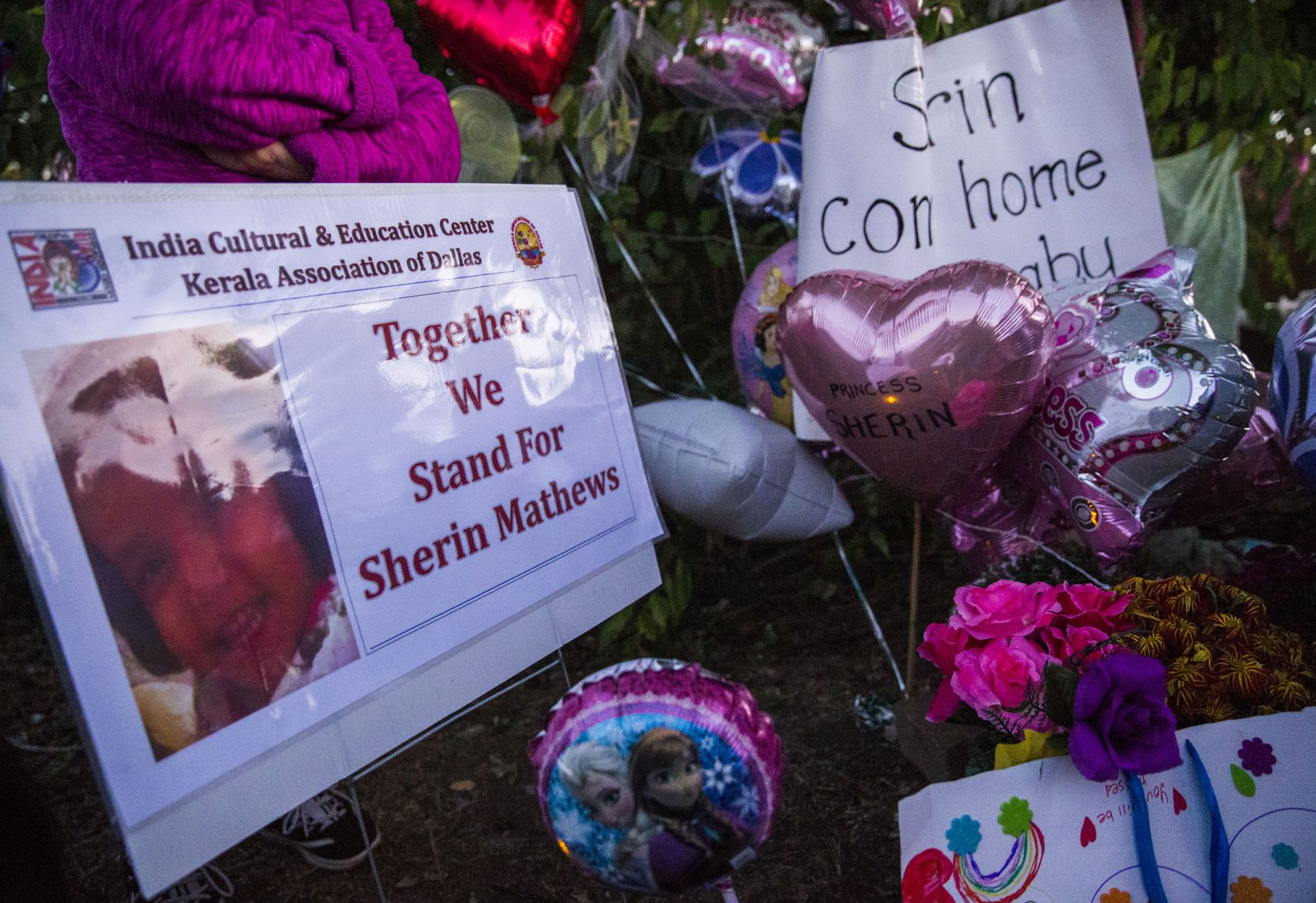 Signs, flowers, balloons and other items collect at a memorial for 3-year-old Sherin Mathews the day her body was found.