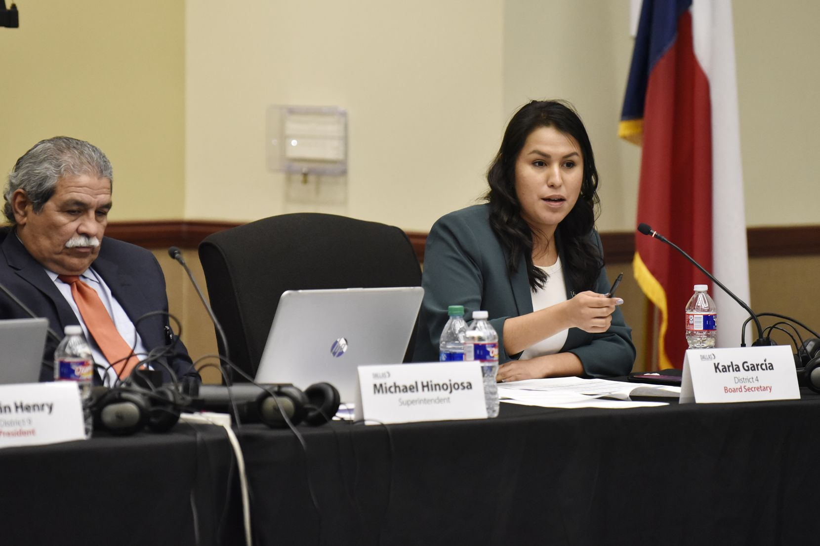 DISD District 4 trustee Karla Garcia, with Superintendent Michael Hinojosa, speaks during a board meeting at the Dallas County Schools Technology and Training Center.