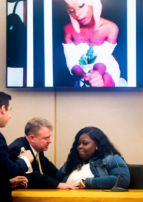 Prosecutor Jason Hermus speaks to Muhlaysia Booker's mother, Stephanie Houston, on Wednesday during the trial of a man accused of assaulting her daughter.