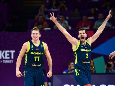 Slovenia's guard Luka Doncic (C) and Goran Dragic (R) celebrate after scoring during the FIBA Eurobasket 2017 men's semi-final basketball match between Spain and Slovenia at the Fenerbahce Ulker Sport Arena in Istanbul on September 14, 2017.