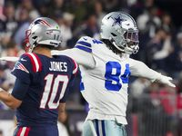 Dallas Cowboys defensive end Randy Gregory (94) celebrates after a defensive stop as New England Patriots quarterback Mac Jones (10) walks off the field during the second half of an NFL football game on Sunday, Oct. 17, 2021, in Foxborough, Mass.