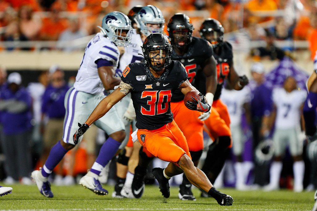 STILLWATER, OK - SEPTEMBER 28:  Running back Chuba Hubbard #30 of the Oklahoma State Cowboys breaks free from the Kansas State Cowboys in the second quarter on September 28, 2019 at Boone Pickens Stadium in Stillwater, Oklahoma.  Hubbard had 296 yards in OSU's 26-13 win.