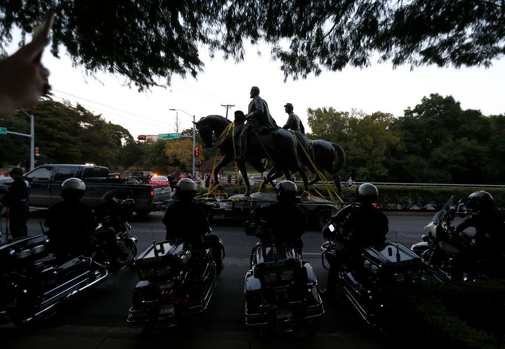 Motorcycle officers wait to escort a truck carrying the Robert E. Lee statue at Robert E. Lee Park on Turtle Creek Boulevard in Dallas, Thursday, Sept. 14, 2017.