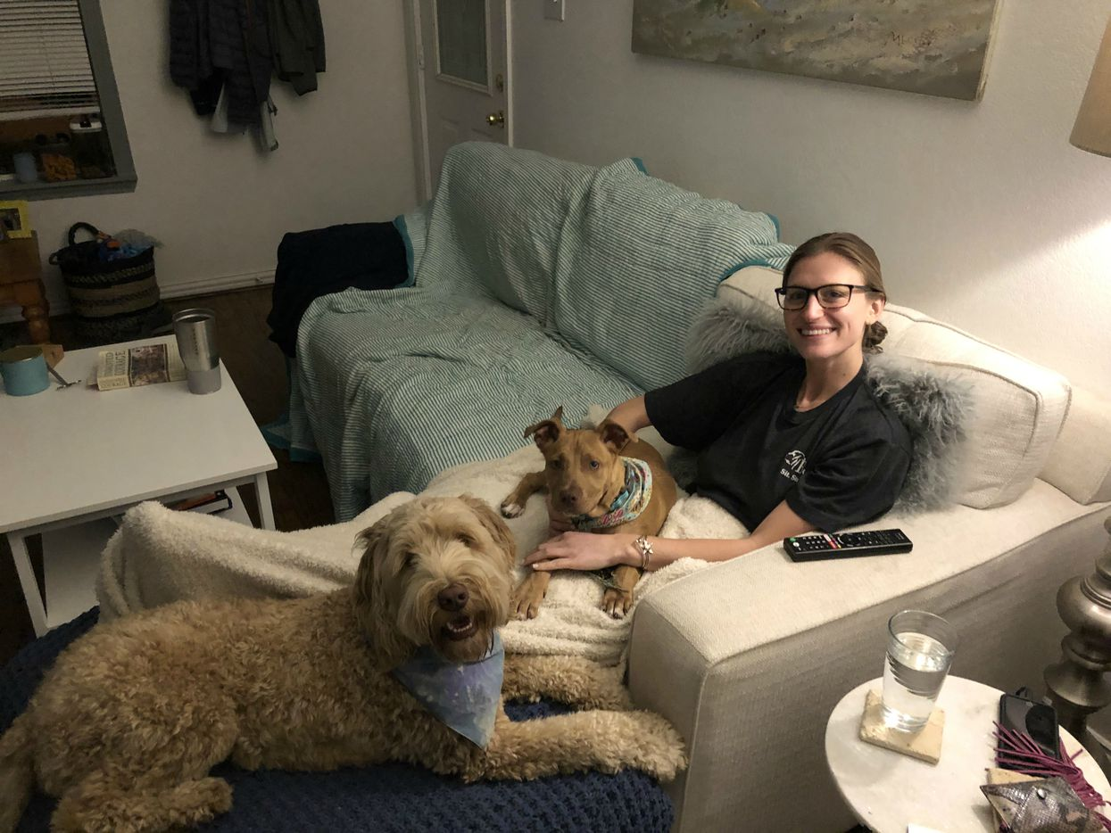 Lexi Sorbara with Biggs, a pit bull mix, and  Jack, an Australian labradoodle, in the Bishop Arts home she shares with husband Drew Morgan.