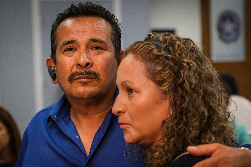 Rogelio Santander hugs his wife Julia Santander during a ceremony at the Dallas Police Northeast Patrol Division honoring their son, slain DPD officer Rogelio Santander, Jr., on Friday, April 12, 2019, in Dallas. Officer Santander died April 25, 2018, after a man he was trying to arrest pulled a gun and opened fire on him at a Home Depot. (Smiley N. Pool/The Dallas Morning News)