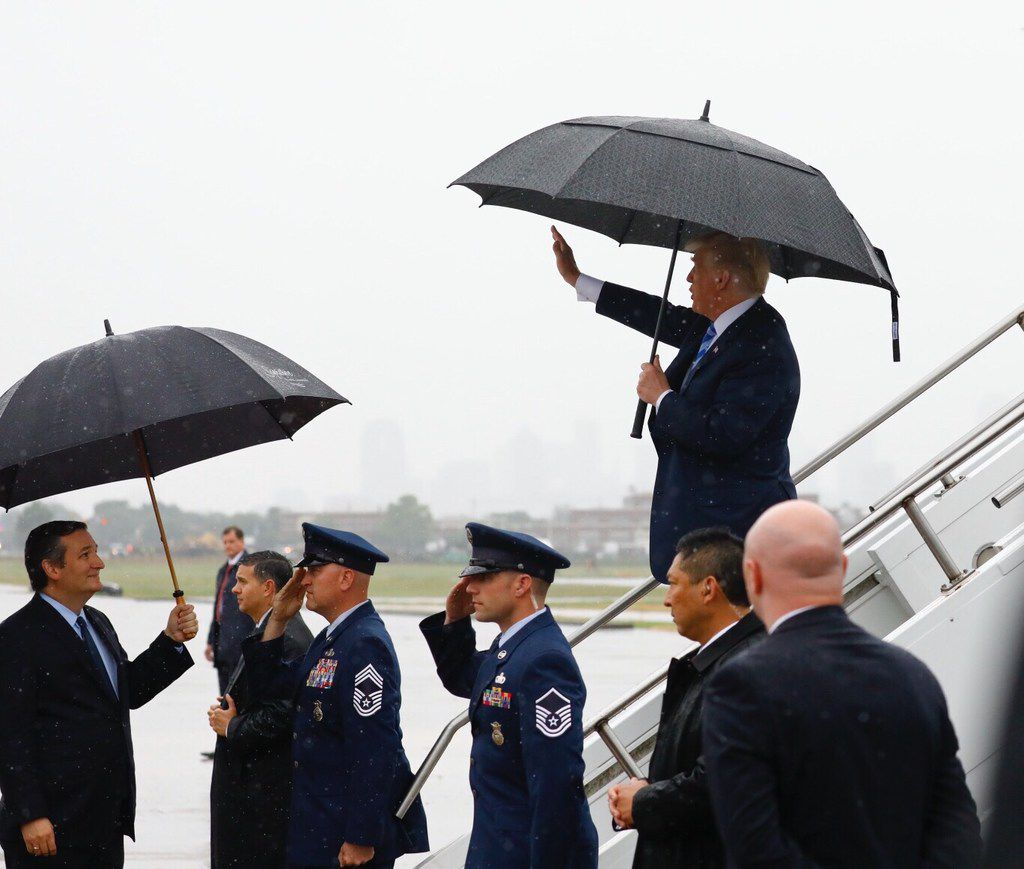 President Donald Trump waves to supporters as he is greeted by Texas Sen. Ted Cruz, left, at Dallas Love Field as he departs Air Force One for the NRA Annual Meeting at the Kay Bailey Hutchison Convention Center in Dallas, on Friday, May 4, 2018. (Tom Fox/Dallas Morning News/TNS)