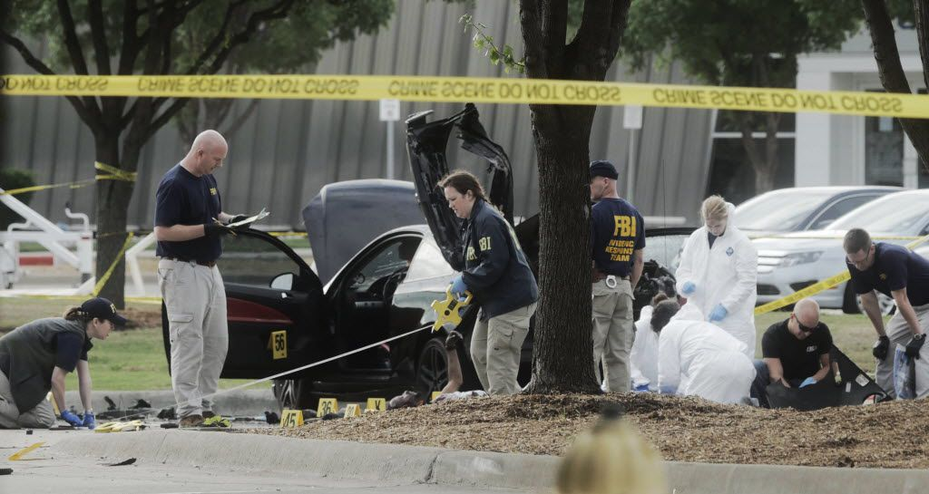 The FBI and Garland Police investigate the scene of a shooting on May 4, 2015, at the Curtis Culwell Center in Garland.