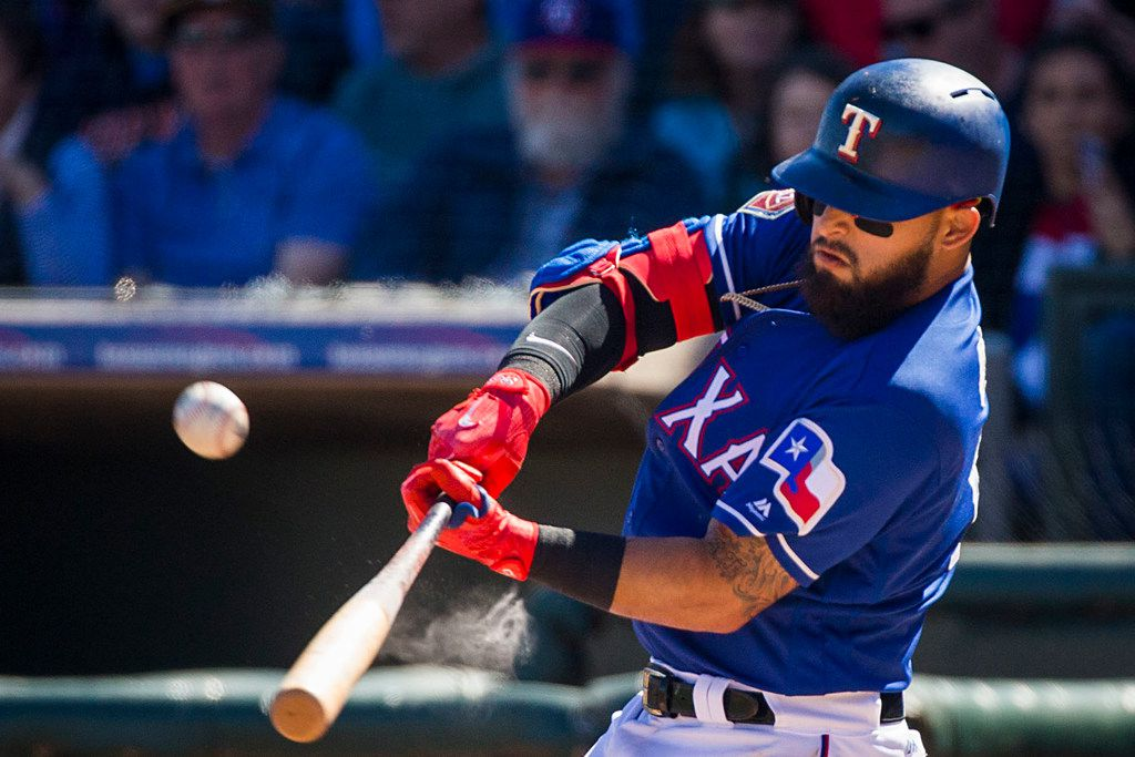 Texas Rangers second baseman Rougned Odor bats during the second inning of a spring training baseball game against the Seattle Mariners on Sunday, March 4, 2018, in Surprise, Ariz. (Smiley N. Pool/The Dallas Morning News)