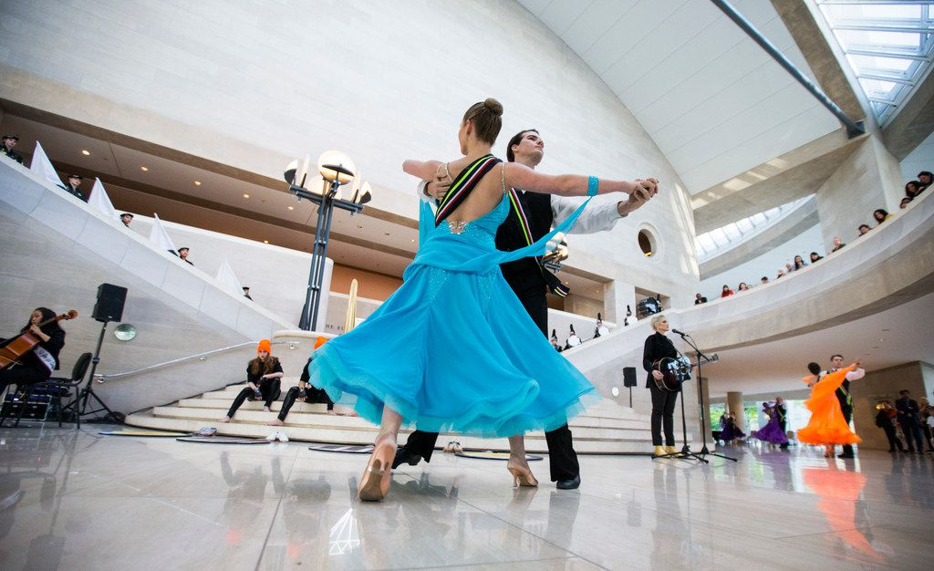 """Olivia Neilands and Ian Axberg of the SMU ballroom dance team perform with musician Sarah Jaffe during a pop-up performance entitled """"Eyes as Bright as Diamonds"""" to kick off the Soluna International Music & Arts Festival on Wednesday, April 11, 2018 at the Morton H. Meyerson Symphony Center in Dallas. The performance brings together New York artist Jen Ray, musician Sarah Jaffe and several Dallas performers. (Ashley Landis/The Dallas Morning News)"""