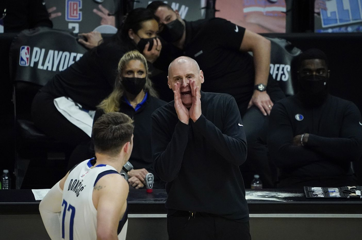 Dallas Mavericks head coach Rick Carlisle gives directions to guard Luka Doncic during the fourth quarter of an NBA playoff basketball game against the LA Clippers at the Staples Center on Wednesday, June 2, 2021, in Los Angeles. The Mavericks won the game 105-100. (Smiley N. Pool/The Dallas Morning News)